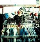 Woman shopping in vintage clothing store