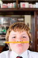 Boy with pencil under his nose