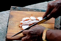 Thailand, Bangkok, Close-up of hands chopping meat on a cutting board