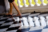 Thailand, Bangkok, Summer Palace at Bang Na, feet and reflections on tiled floor
