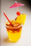 A mai tai garnished with pinapple and a cherry