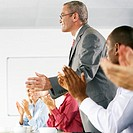 Businesspeople Applauding in Presentation