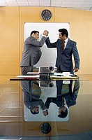 Two Businessmen High-Fiving