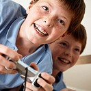 Portrait of Identical Twin Boys Playing Video Games