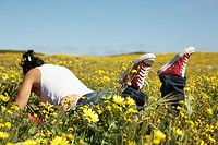 Couple Lying in Wild Flower Meadow