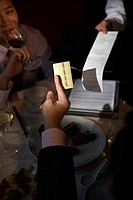 Businessman Paying By Credit Card at Restaurant