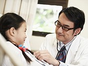 Doctor Examining Young Patient
