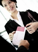 Businesswoman Getting Airline Ticket