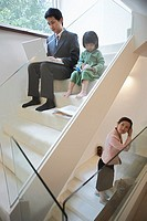 Busy Family on Stairs