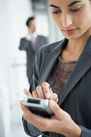 Businesswoman using personal digital assistant