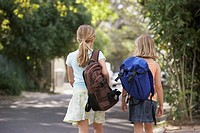Girls walking with backpacks
