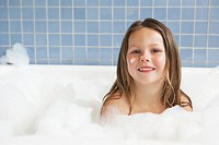 Girl taking a bubble bath