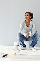 Woman sitting on paint cans