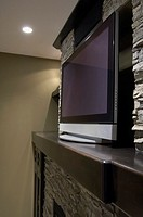 Flat screen television on fireplace mantel