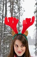 Woman wearing a reindeer hat