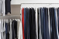 Rack of t-shirts and jeans