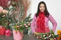 Florist standing behind table with flowers