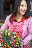 Florist carrying bunch of tulips