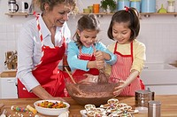 Children and mother making gingerbread cookies