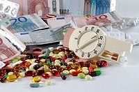 Several, kind, of, pills, euro, notes, and, insulin, syringe, tablets,