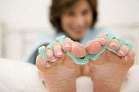 Close-up of a mature woman´s feet with toe dividers