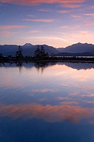 Reflection of clouds and mountains in water, Hood Canal, Olympic Mountains, Washington, USA