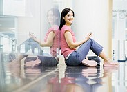 Portrait of Hispanic woman sitting on floor