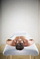Man laying on massage table