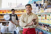 Hispanic father and son working in family owned bodega