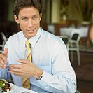 Businessman eating at restaurant