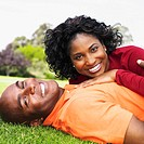 African couple laying in grass