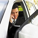 Hispanic businessman talking on cell phone (thumbnail)