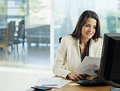 Woman in office working on her personal computer