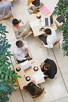 Aerial view of businesspeople with laptop and coffee