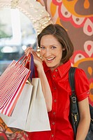 Woman with shopping bags smiling