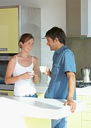 Man and woman in kitchen with coffee