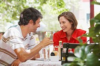 Man and woman at restaurant with wine
