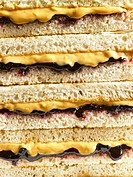 Stack of peanut butter and jelly sandwiches, close-up