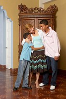 Hispanic mother and sons hugging