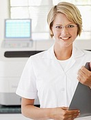 Woman with eyeglasses holding clipboard smiling