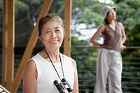 Senior Asian woman with binoculars
