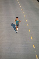 ´Man jogging on street, elevated view´