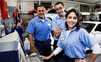 Group of auto mechanics in auto repair shop