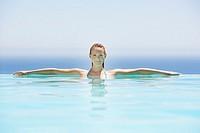 Woman in infinity pool