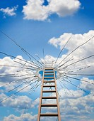 Ladder leading to hole in sky, low angle view digital composite