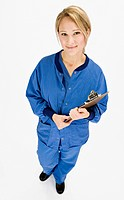 Studio shot of woman in uniform with clipboard