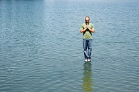 Man standing on water praying