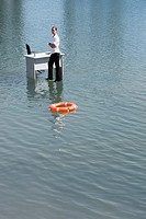 Businesswoman standing on water with floating device