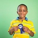 African boy holding birthday ribbon