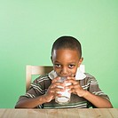 African boy drinking glass of milk